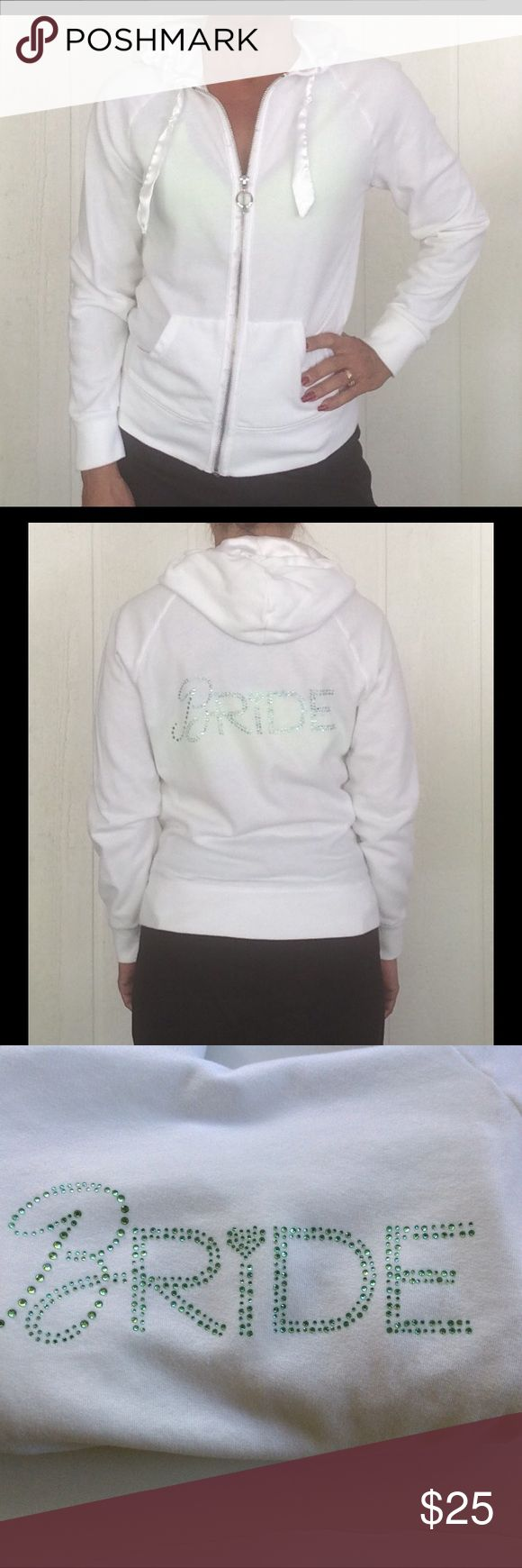 """VICTORIAS SECRET BRIDAL HOODIE EUC Victoria's Secret """"I Do"""" bridal collection hoodie.  Zip up hoodie embellished with blue rhinestones on The back that spells out bride.  this is the perfect accessory that every bride needs while getting glammed up for your wedding!  Zip up with two front pockets.  Hoodie interior is lined with satin and has several pulls but not noticeable.  Satin drawstring on hood.  Adorable wedding ring with crystals for the zipper pull.  No rips, holes, or stains.  No…"""