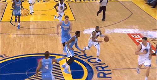 Andre Iguodala shakes Quincy Miller
