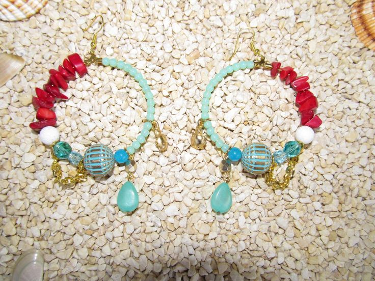 Handmade earrings (1 pair)  Made with semiprecious stones, glass beads, embossed plastic beads and metal findings.