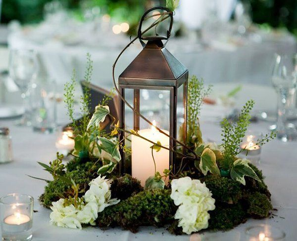 Woodland feel: a lantern & moss centerpiece.