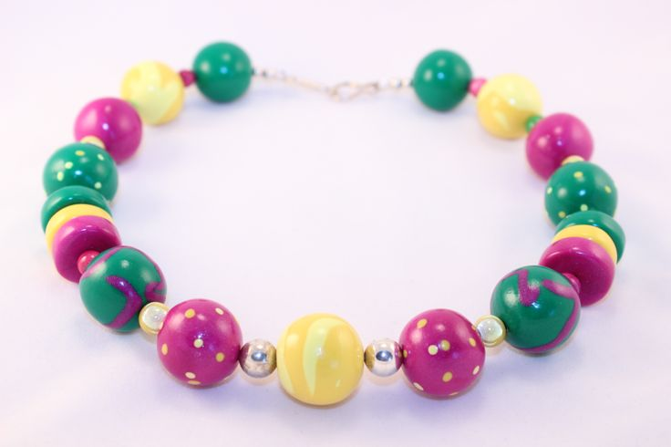Zings 110 - NEW!    Symmetrical style featuring brilliant yellow, fuchsia and Kelly green with miracle beads, shell amethyst and glass.  Please visit www.girlsilver.ca for purchasing info.