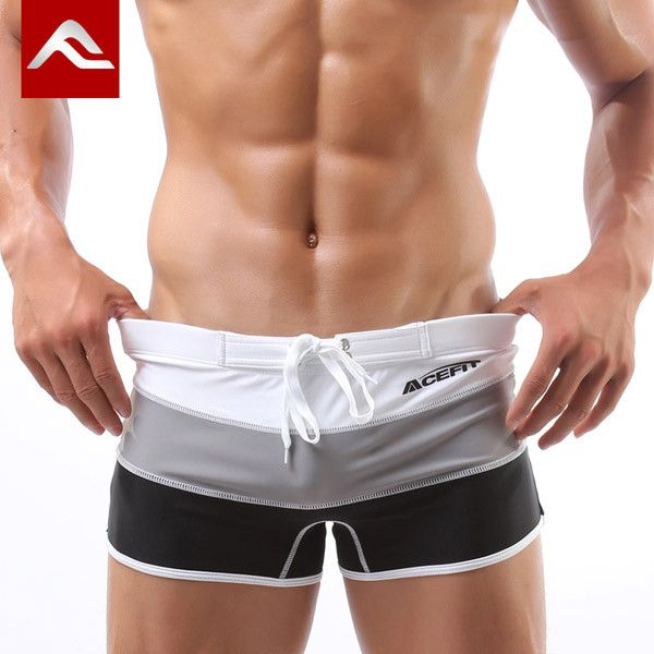 New 2016 Men Swimwear Sexy swimming trunks Low waist Stripe Patchwork Shorts Boxers Sports suit Mens comfortable Swimsuit man