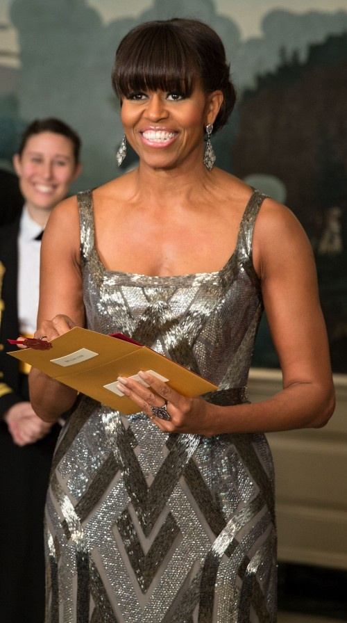 First Lady Michelle Obama certainly looked Oscar worthy in a silver, pewter, and gray metallic beaded dress and matching drop earrings as she announced the winner of the Oscar for Best Picture: Argo, the story of the rescue of six Americans from the Canadian embassy in Iran during the hostage crisis in 1980.