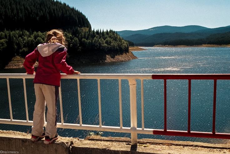 an English girl in Romania near the edge of a dam