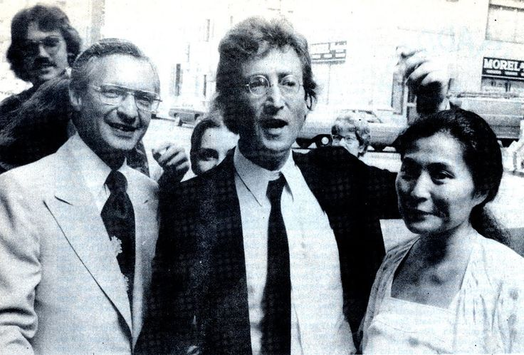 """See that guy in the background behind John's lawyer?  That's Brian Cunningham.   He is a fan who happened to to the immigration office the day that John got his Green Card on 7/27/1976. Here is what Brian had to say about meeting John and getting his autograph.""""I grabbed his left arm as he walked out and faced reporters and asked for his autograph! I then asked if that was Yoko next to him(please be advised I was as nervous & didn't know what else to say). His reply was 'no, it's me mother!"""""""