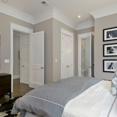 Wide crown molding, trim above doors, not a standard door style either.