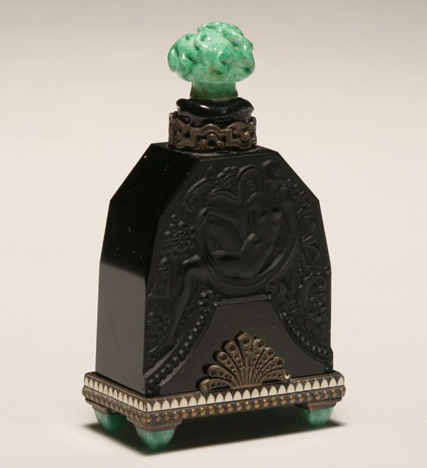 "Heinrich Hoffman design Art Deco perfume bottle; molded female nude in black crystal on enameled base with jade crystal feet. Intaglio Hoffman mark. 4 1/2""H. Pinched jade stopper is damaged and missing dauber. Missing marcasites on collar and base."