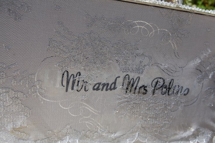 Other side proudly displays the Mr & Mrs.through silver lace.
