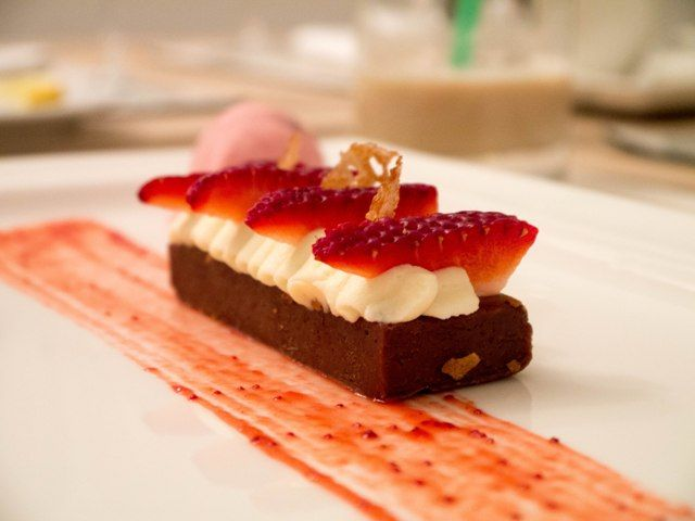 Praline tart with mascarpone mousse and strawberries at Signature Restaurant in Warsaw