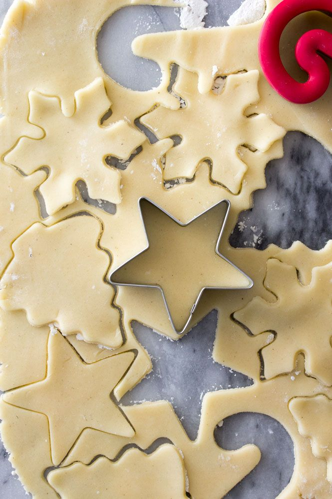 Cutting out sugar cookies from sugar cookie dough