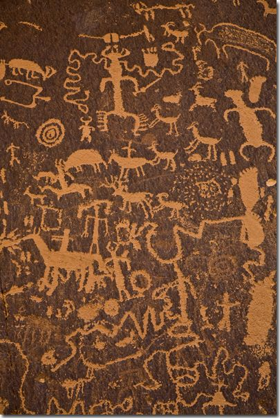 Newspaper Rock is one of the largest known collections of petroglyphs. They are etched in sandstone and record over 2,000 years of human activity in the area, representing the Fremont, Anasazi, Navajo and Anglo cultures.