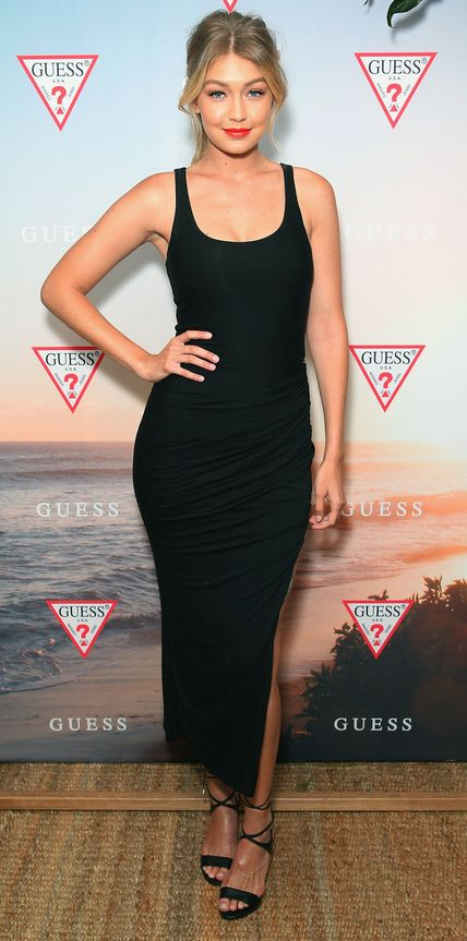 Gigi Hadid celebrated the launch of the Guess spring 2015 collection in Sydney in a sexy curve-hugging LBD with a zip-up detail along the side, complete with strappy black patent sandals.