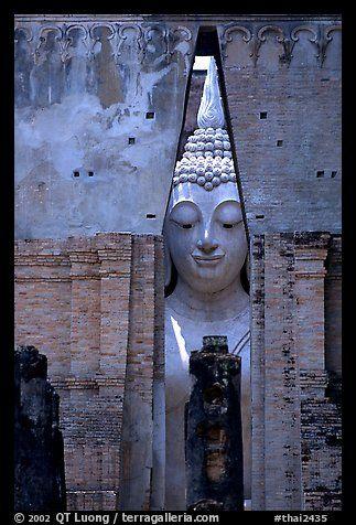 Monumental Buddha image seen between walls, Wat Si Chum. Sukothai, Thailand