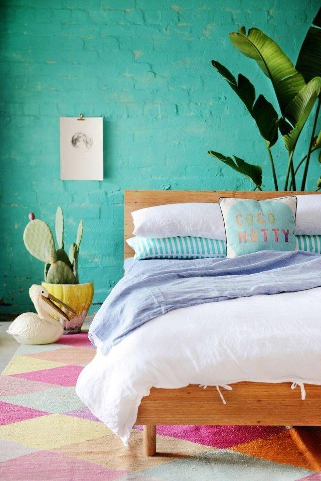turquoise walls + geometric rug
