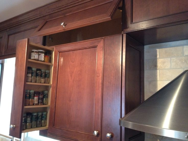 A hidden spice rack has the potential to de-clutter your space.