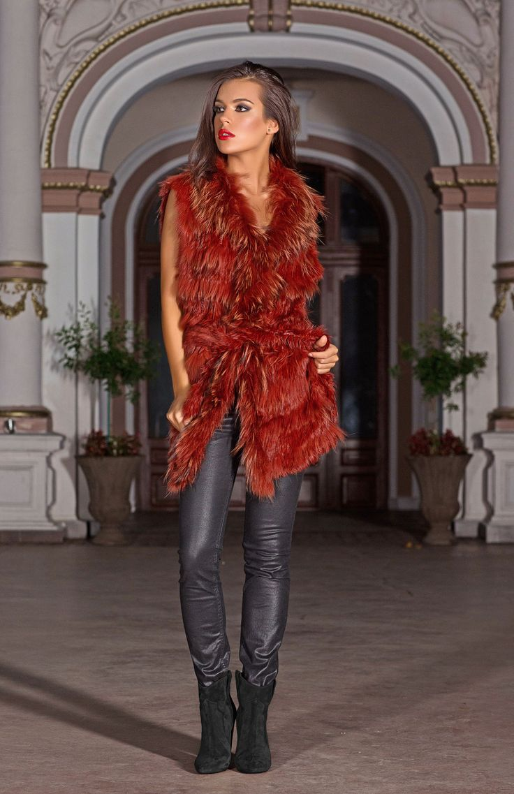 Coloured fur has been a big hit on the catwalks this season and now you can choose to be daring with the firey tones of our Cerise jacket. The oversize cut makes this gilet perfect for layering - with or without the co-ordinating belt.