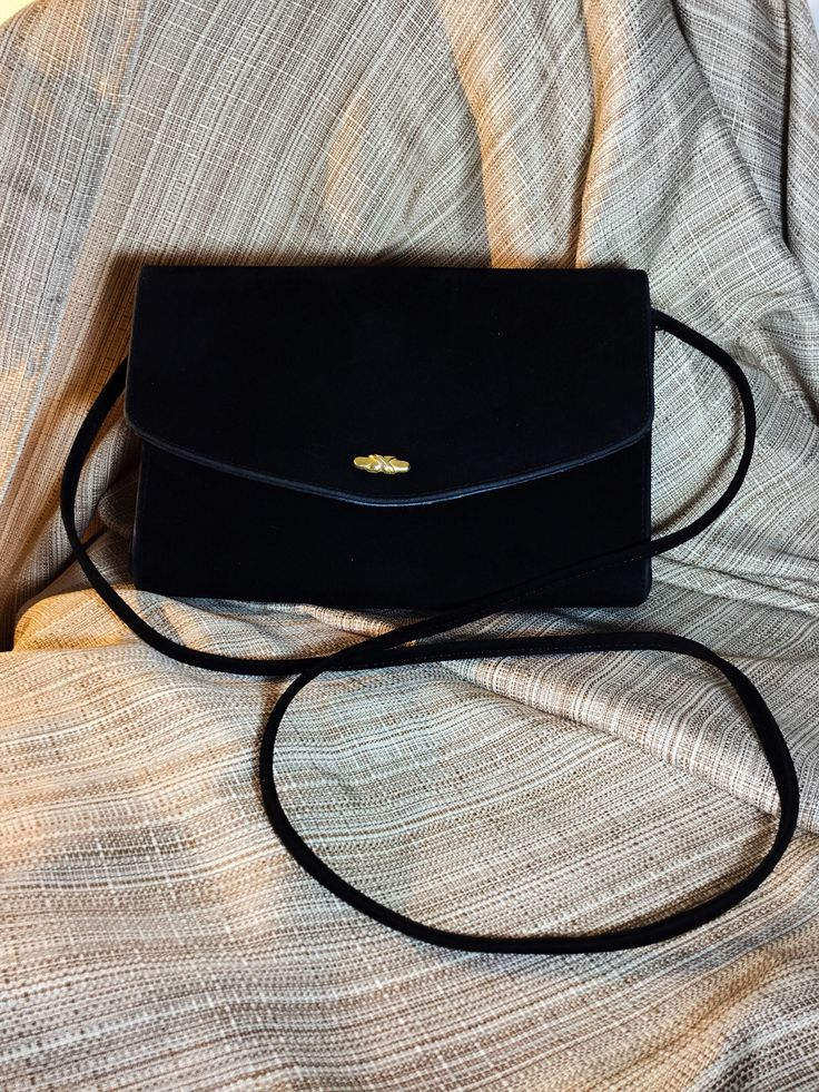 A personal favorite from my Etsy shop https://www.etsy.com/ca/listing/575698087/1960-black-velvet-retro-shoulder-bag