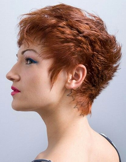 A great choppy, short, easy to maintain hairstyle in a wonderful coppery red shade!