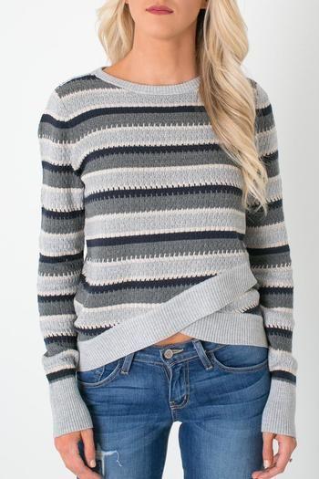 ↞ Apricot Lane Centennial ↠ Olive & Oak striped knit sweater featuring a criss crossing hem line.