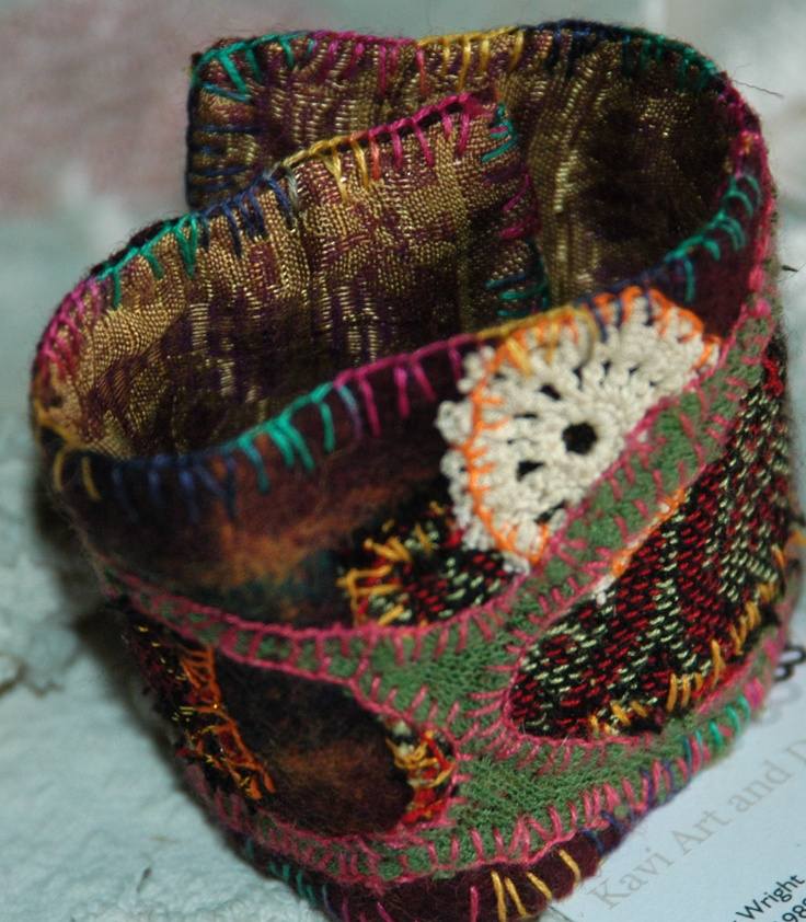 Fabric cuff- 4 cm wide.  Pieceworked cuff featuring  woolen fabric and 1960s scarf.  Lined with vintage sari fabric.
