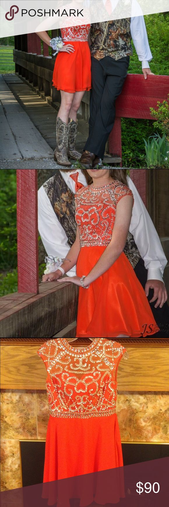 Orange Formal Dress Knee length orange chiffon formal dress. Zipper back. Fully lined. Mesh shoulders with beautiful silver beading and sequins. Excellent condition. Loving Dresses Dresses Prom