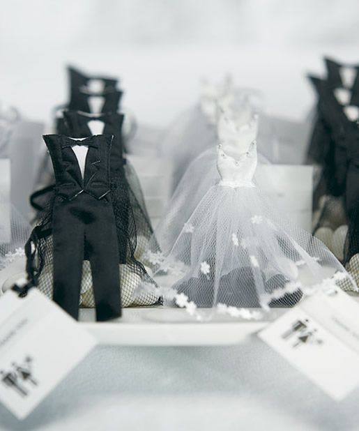 Adorable favor bags dressed in tuxedo and #wedding dress