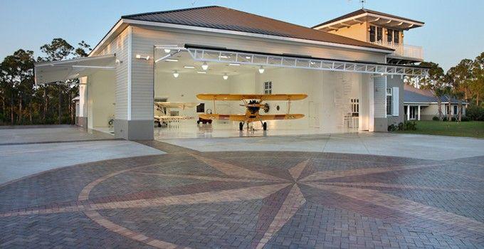 Another beautiful hangar home hangar homes pinterest for Hangar home designs