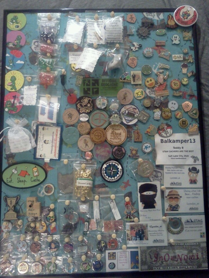 Our Swag Board. Took old pic, covered cardboard in treasure pirate fabric and then screen over that and gathered our path tags, pins, siginutare items and misc caching items and pinned them with woodedn push puns. WE LOVE IT!