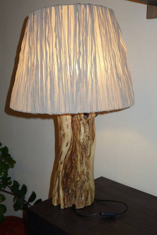 This lamp is made from a acacia tree trunk.