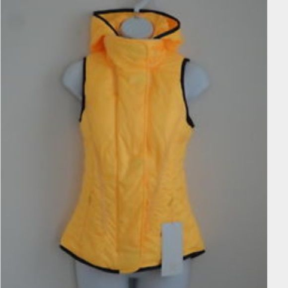 •HUGE SALE• RARE NWOT FUZZY HOODED LULULEMON VEST• •RARE NWOT SUPER SOFT FUZZY HOODED LULULEMON VEST LOWEST PRICE YOULL FIND ANYWHERE RETAILED $200. This Lululemon vest is brand new without the tags.  a beautiful yellow and very soft and fluffy.  The hood is removable and the vest zips up on the inside and then flaps over to cover this part with some very cool invisible magnetic buttons. The Lululemon emblem is reflective and on the back and then there is a very cool large embroidered one on…