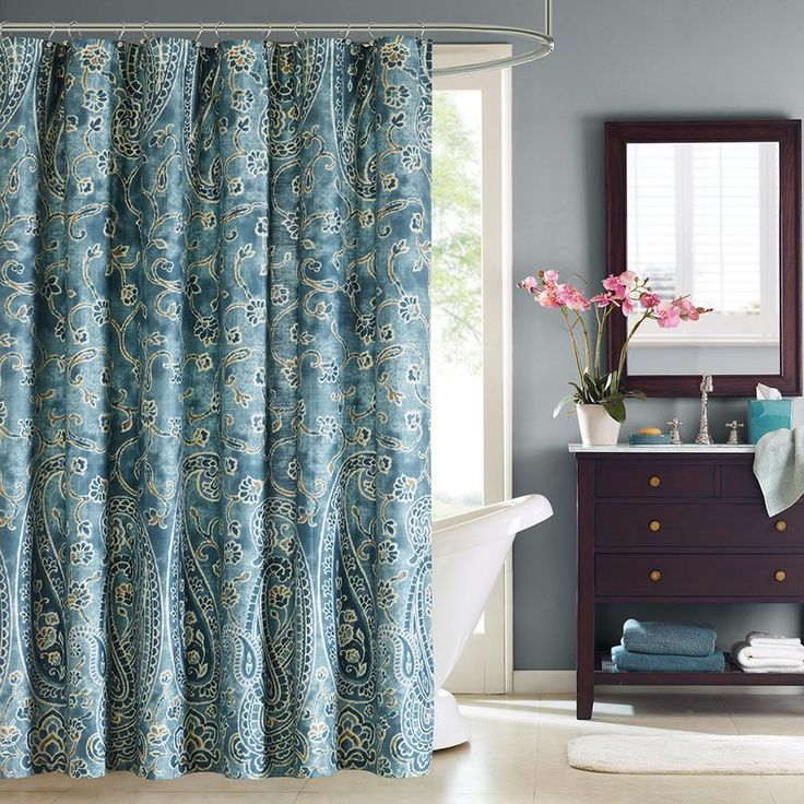 Spruce up your space with the Harbor House Belcourt Cotton shower curtain. This elegant shower curtain is made from 100% cotton and features a repeating paisley pattern in dusty blue.