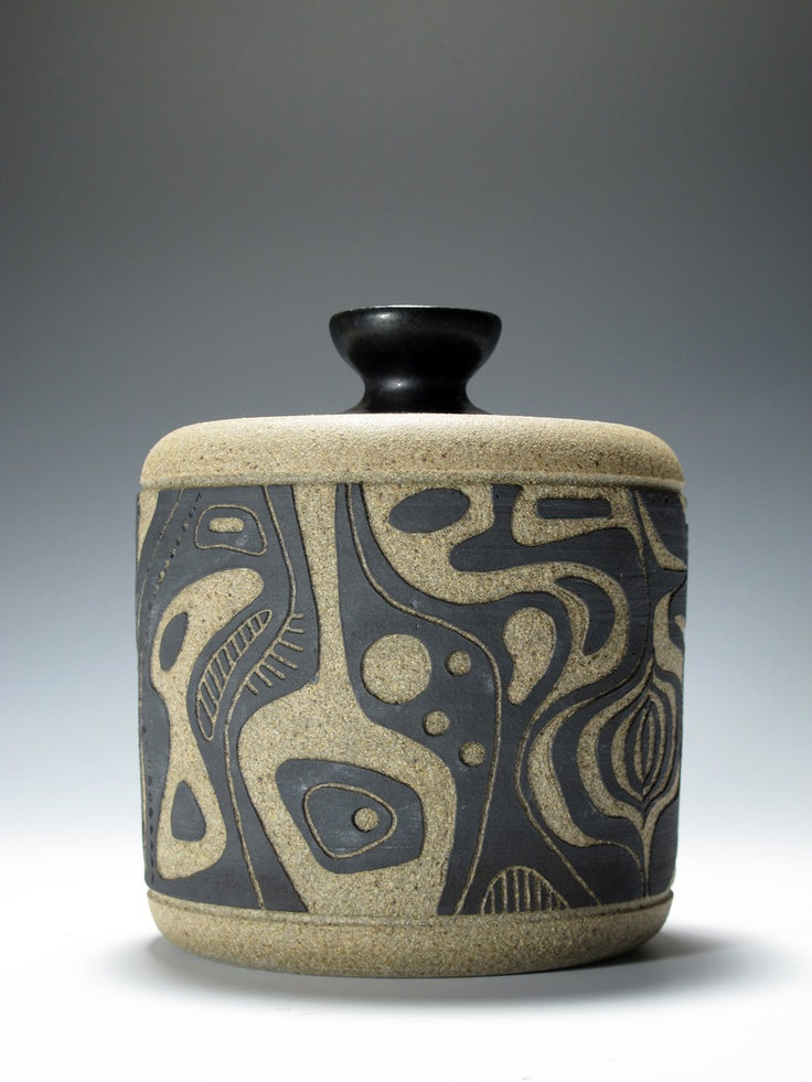 Stoneware jar with an modernist abstract design carved ...