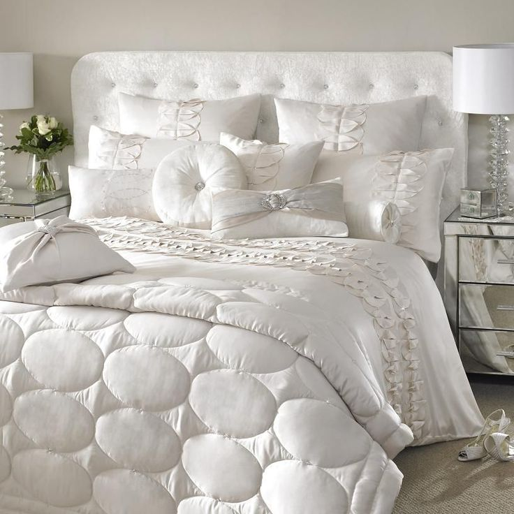 Kylie Minogue at home white bedding http://www.bykoket.com/blog/luxury-bed-set-trends-2014/