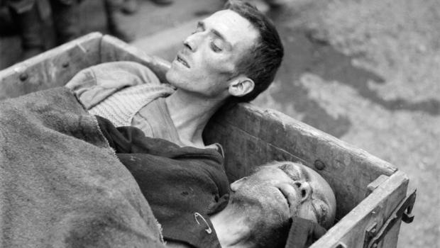 Two dead prisoners are taken away in a cart after Dachau was liberated by U.S. troops, May 1945.  Soldiers arrived to find surviving prisoners, as well as a number of unburied bodies left by the fleeing SS. Credit: Eric Schwab/AFP/Getty Images