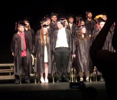 Chloe graduates high school