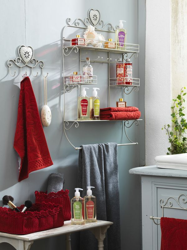 Guest bathroom wall color and decor idea.. Love the red and silver together