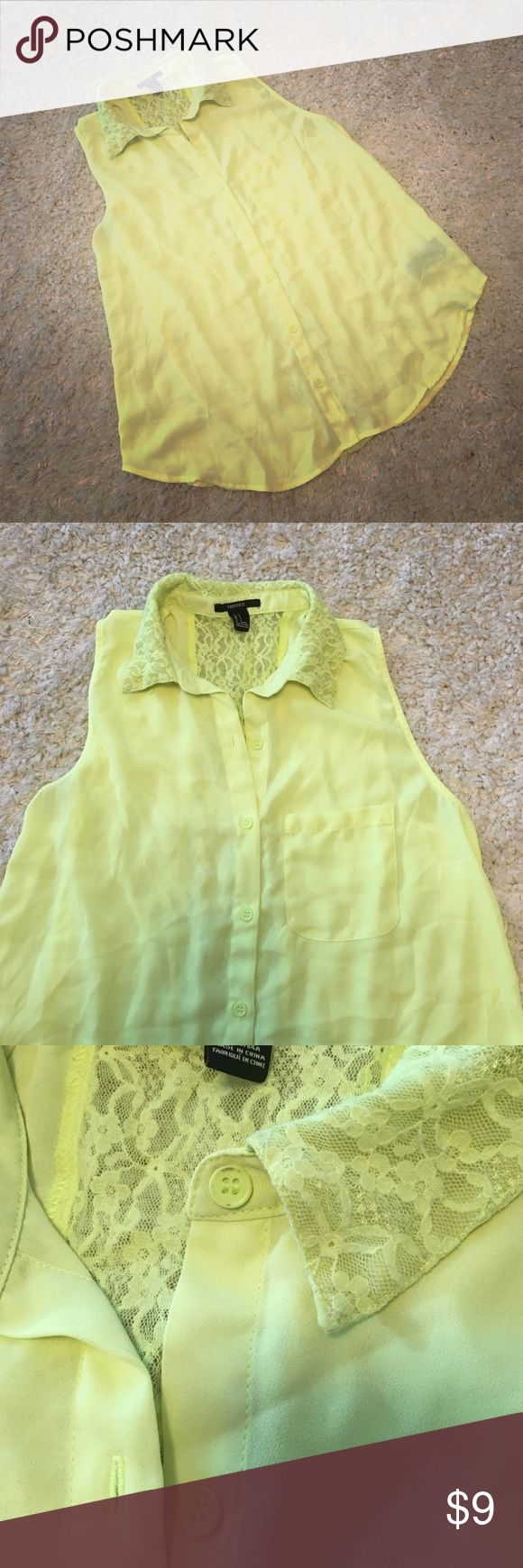 Forever 21 neon yellow top with lace detail. SizeS Forever 21 top. Size small. Neon yellow. Lace collar and back panel detail. Button front closure. The top button has a mark as seen in picture 3 but when you wear it you don't notice. Please let me know if you have any questions. Thanks! Forever 21 Tops Blouses