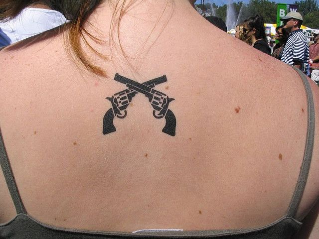 109 best girls with gun tattoos images on pinterest for Gun holster tattoo