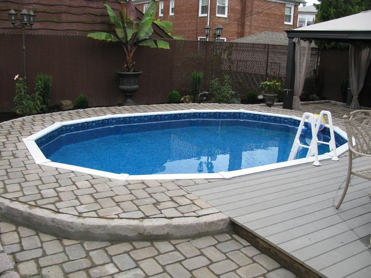 intriguing semi inground pools with payer deck material, photo