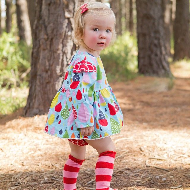 Our Crazy Rain print Nina Dress is a short smock with free matching bloomers for sizes 0 & 1 year. No getting tangled up in a dress for these cute little legs! Miss Harper could not look cuter in her shortie dress, bloomers and matching knee-hi socks and Oobi print hair bow. It'll transition perfectly from Summer to Autumn!