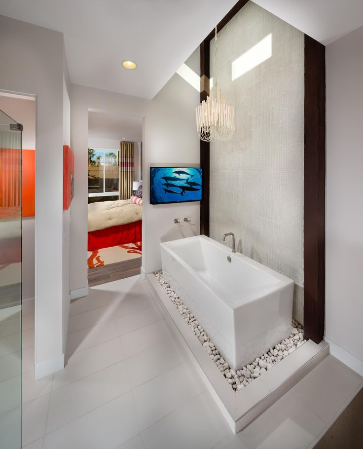 Photography Gallery Sites Minimalist modern master bathroom with elevated tub on white rocks