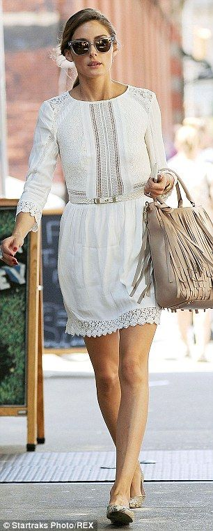 #casualwear #streetstyle | Olivia Palermo in a Heartloom white belted lace cotton dress styled with a Carolina Herrera beige fringed tote and flats