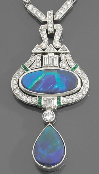 An Art Deco black opal, diamond, emerald & platinum necklace, ca 1930. An articulated pendant featuring two black opals, mounted in platinum, set with brilliant-cut & baguette diamonds & calibré-cut emeralds.
