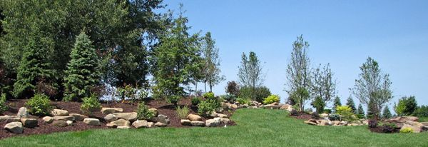 Property Line Landscaping | property line landscaping around patio lawn install mounded landscape ...