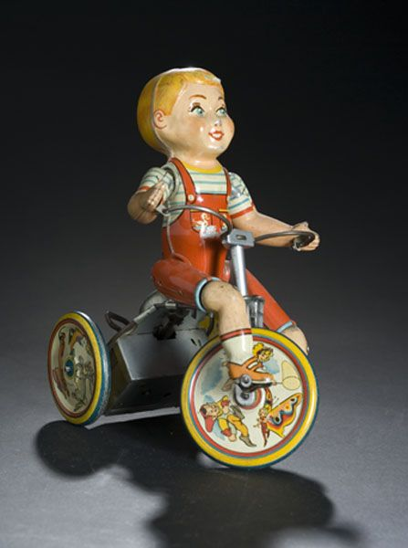 Unique Art tin windup toy of a Kiddy Cyclist mounted on a tricycle 1940 - 52