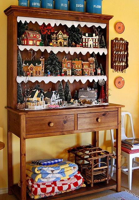 Nice Christmas Village set up on an old dresser