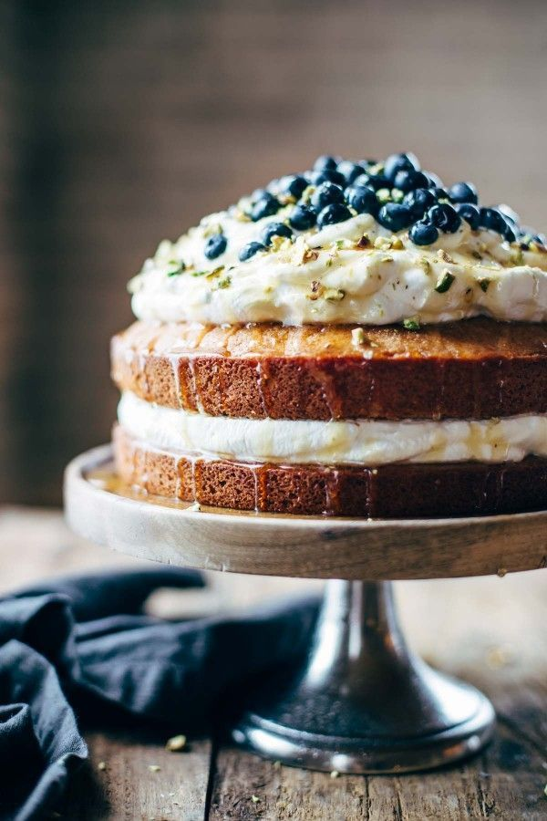 Orange Brunch Cake - SUPER YUMMY because it's made with olive oil and whole oranges! topped with whipped cream and blueberries and you're in fancy brunch business.