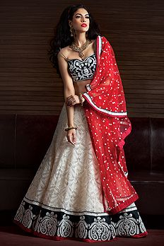 Lucknowi net ghagra with rawsilk blouse and net dupatta embellished with thread and pearl work