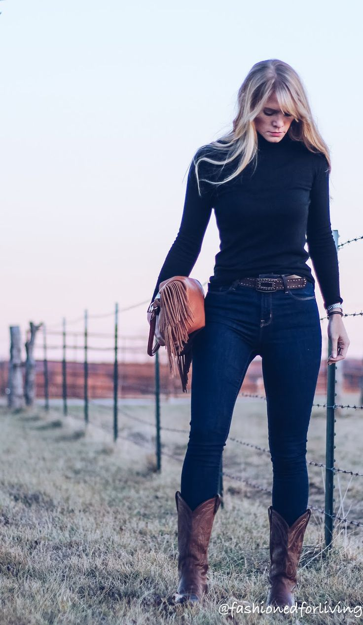high waisted jeans outfit with cowboy boots and black turtleneck