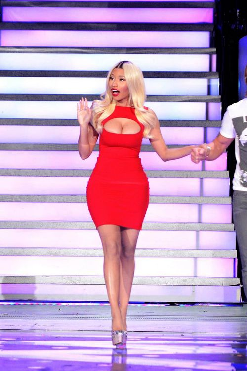 Nicki Minaj busts out of red dress in cleavage-popping outfit on American Idol
